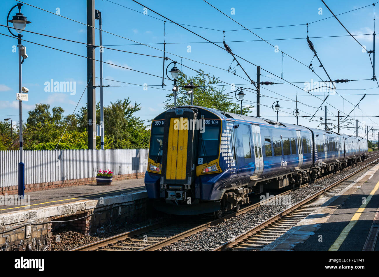 ScotRail train leaving Drem Station in Summer with blue sky, East Lothian, Scotland, UK - Stock Image