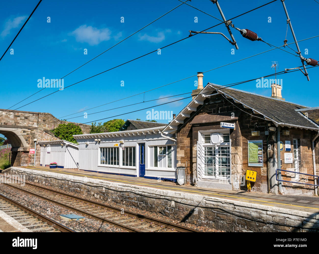 Rural train station platform with quaint waiting room on Summer day with blue sky, Drem Railway station, East Lothian, Scotland, UK - Stock Image