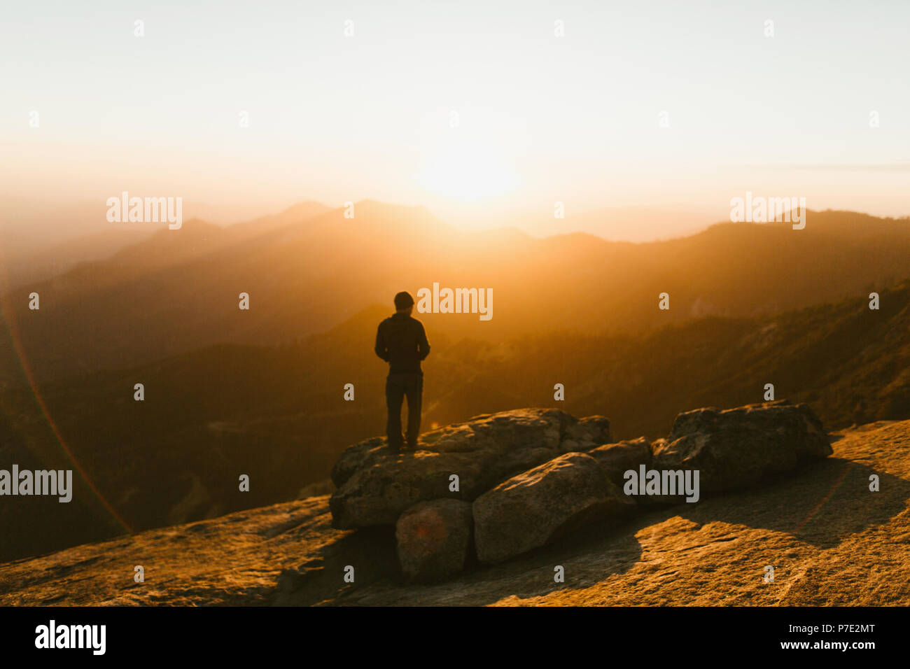 Man looking away at view of mountains at sunset, Sequoia National Park, California, USA - Stock Image