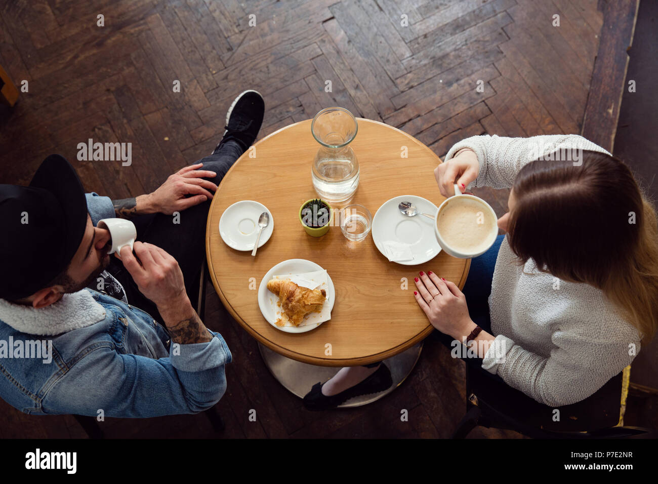 Couple having coffee in cafe - Stock Image