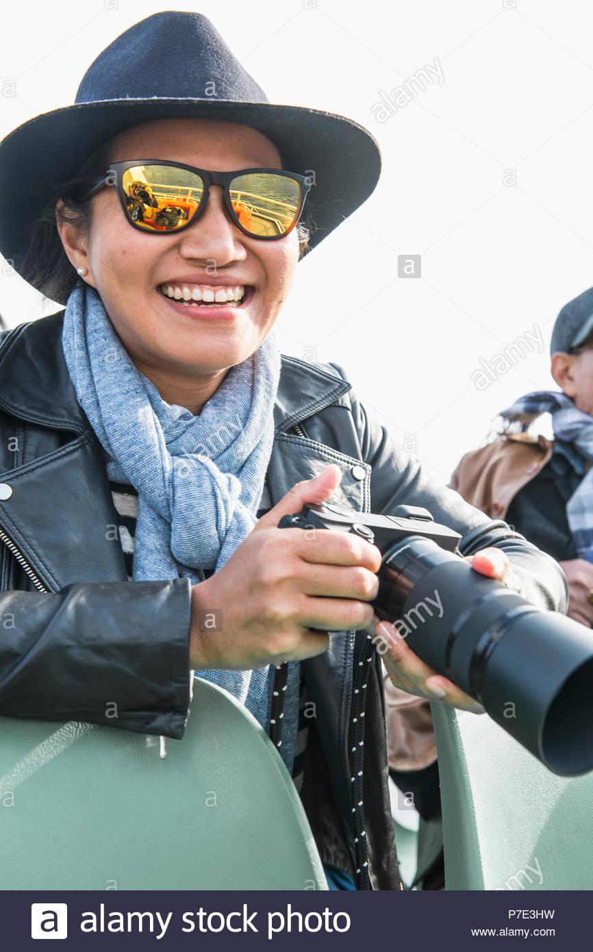Woman with digital rangefinder camera - Stock Image