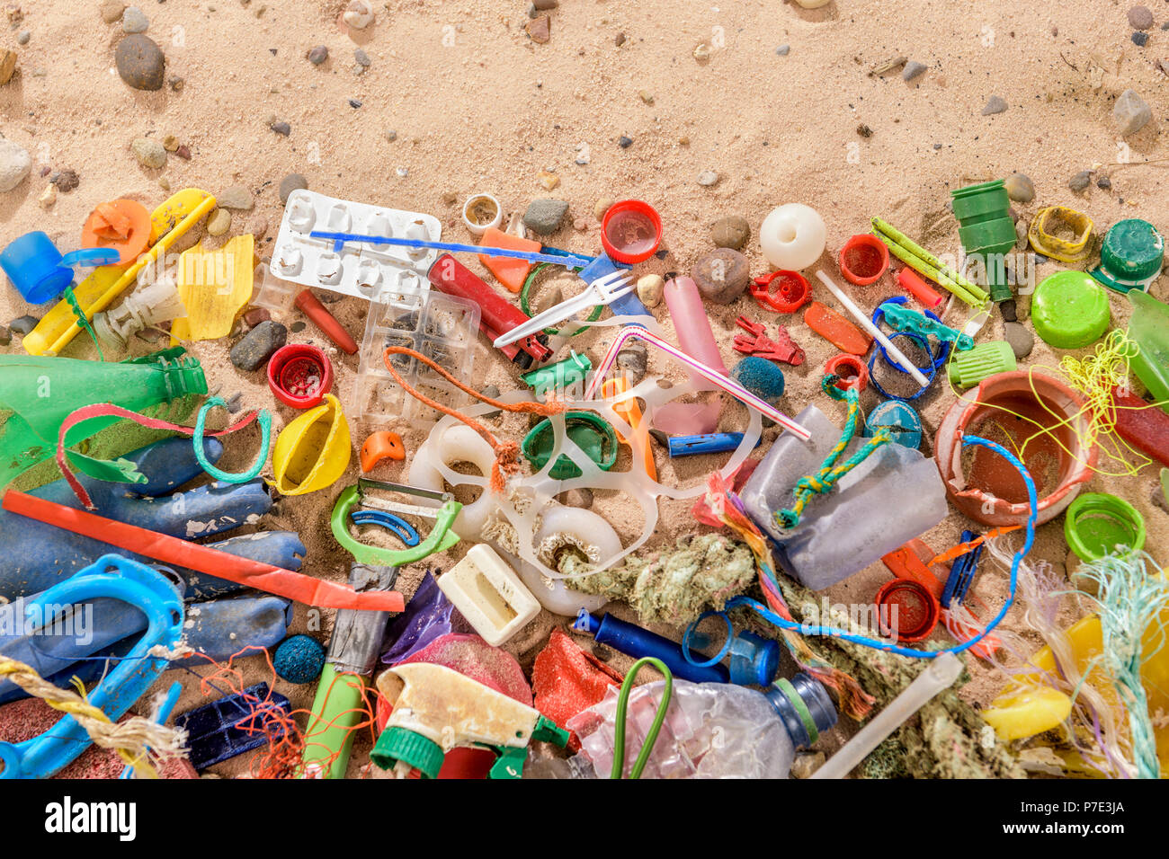 Discarded and polluting plastic garbage on sand collected from beach in North East England, UK - Stock Image