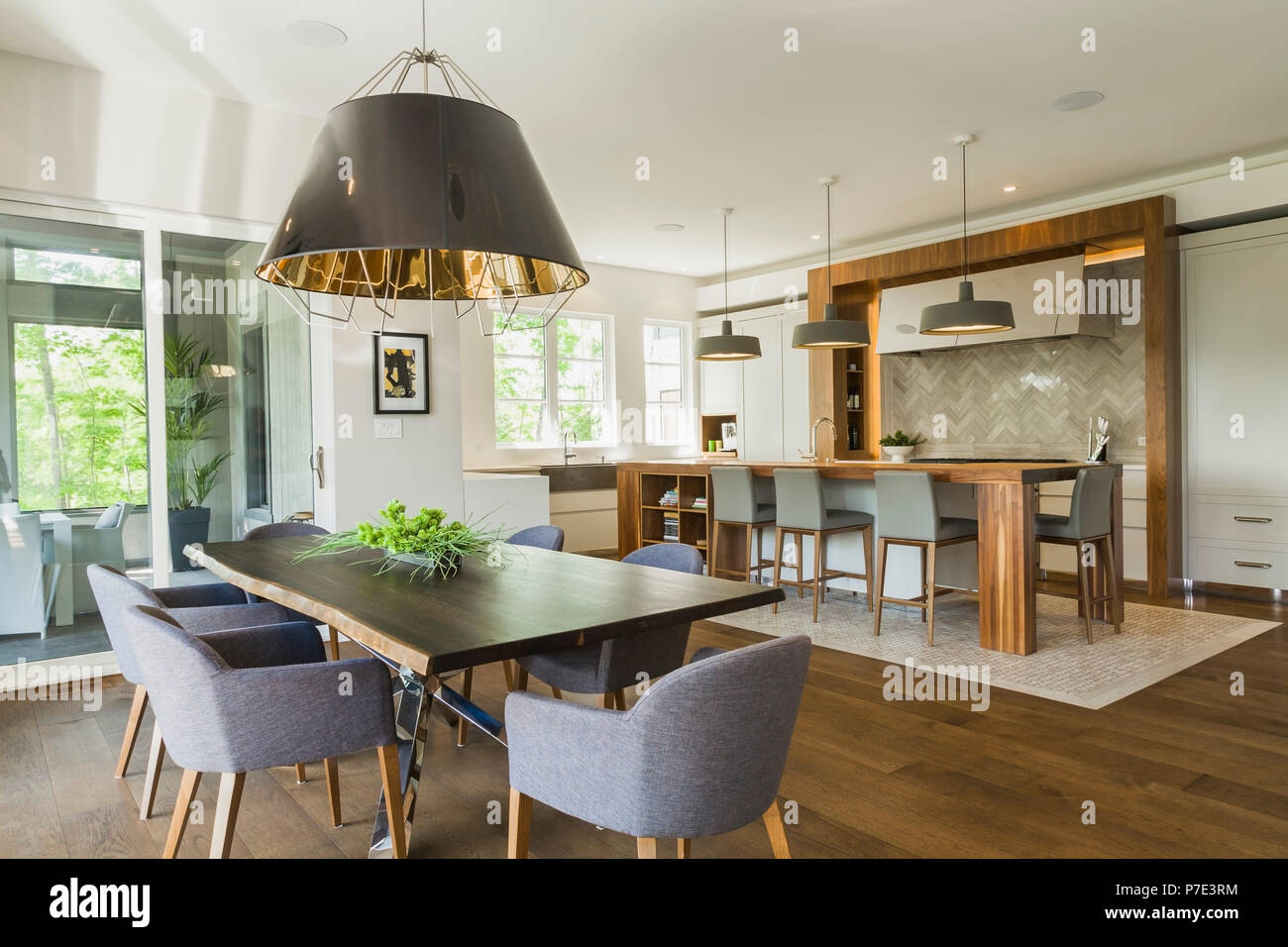 Dining room and kitchen area inside a luxurious contemporary home