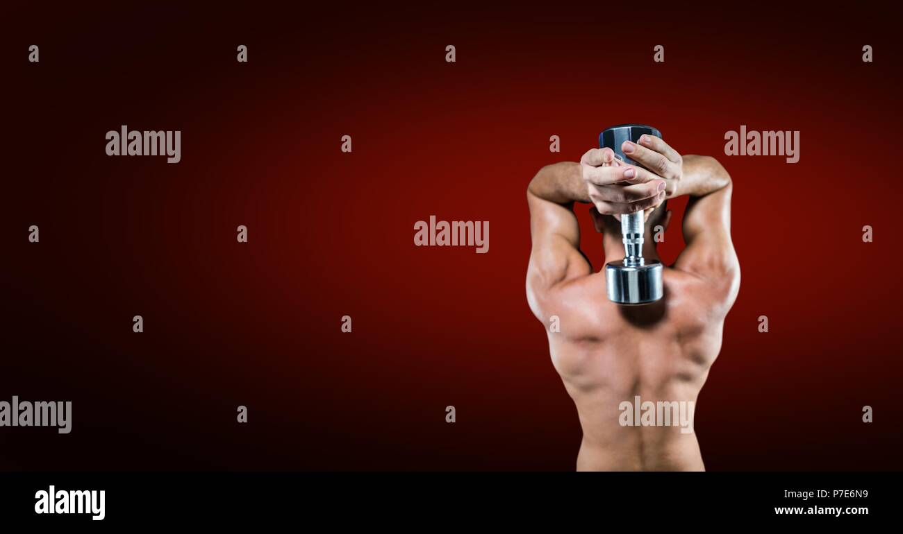 Bodybuilding weight lifter man with blank red background - Stock Image