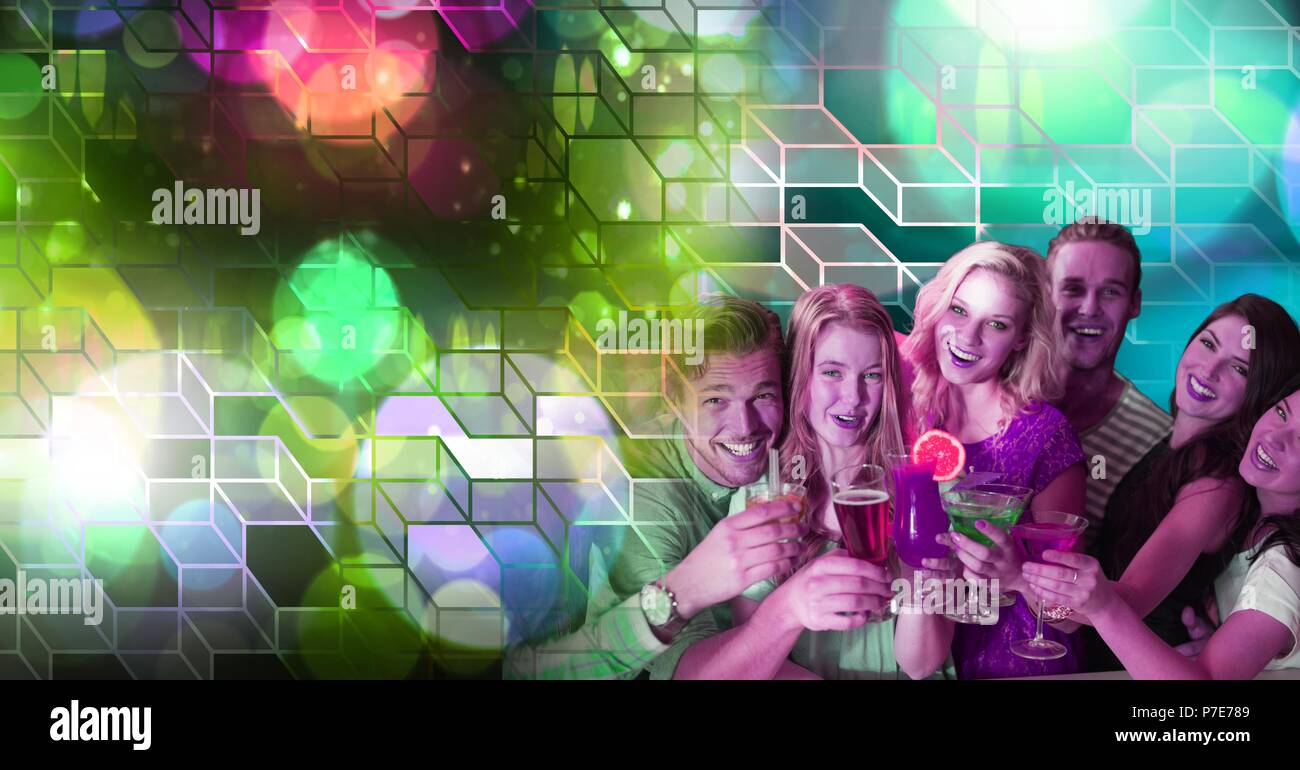 Fun friends drinking cocktails with geometric party lights venue atmosphere - Stock Image