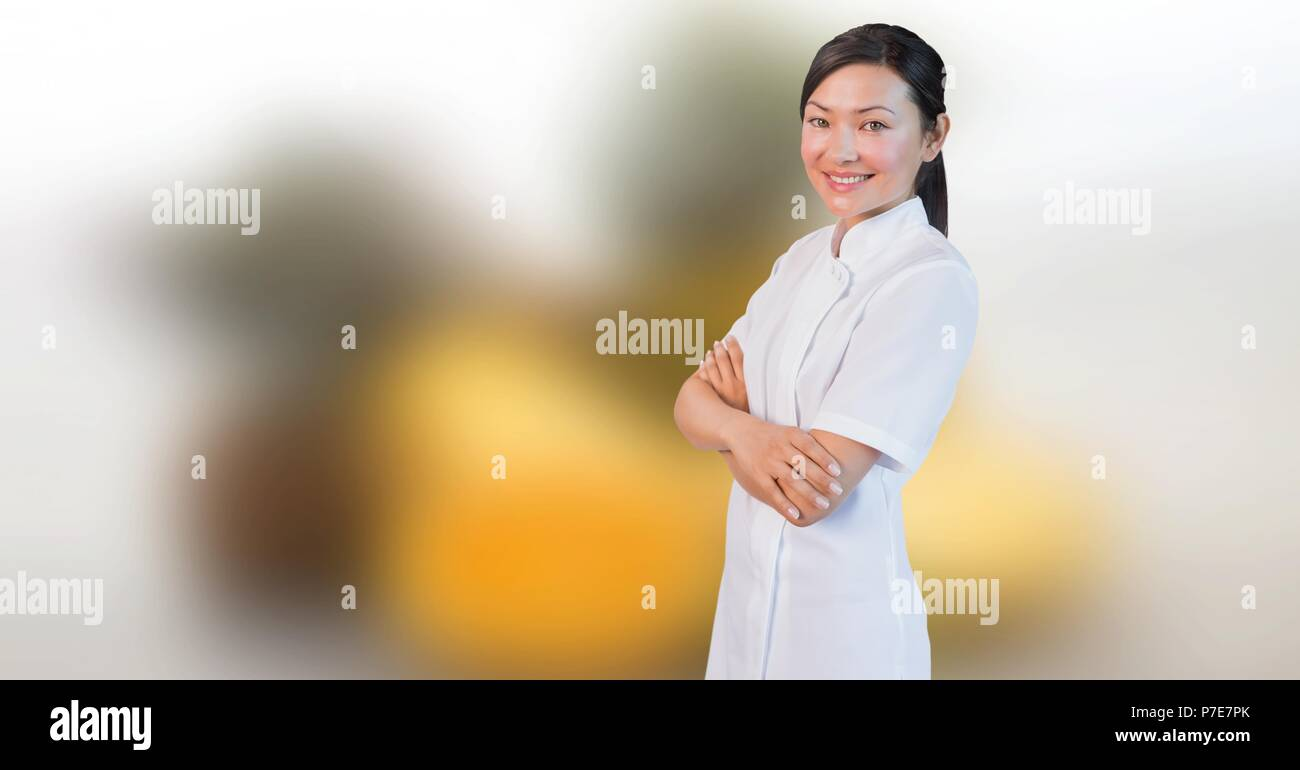 Happy spa masseuse woman relaxed with blurred background - Stock Image