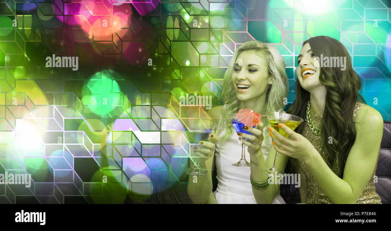 Fun women drinking cocktails with geometric party lights venue atmosphere - Stock Image