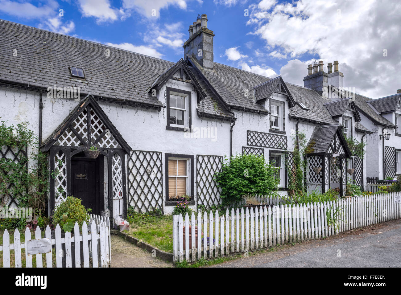 Row of white houses in the village Kenmore, Perth and Kinross, Perthshire in the Highlands of Scotland, UK - Stock Image