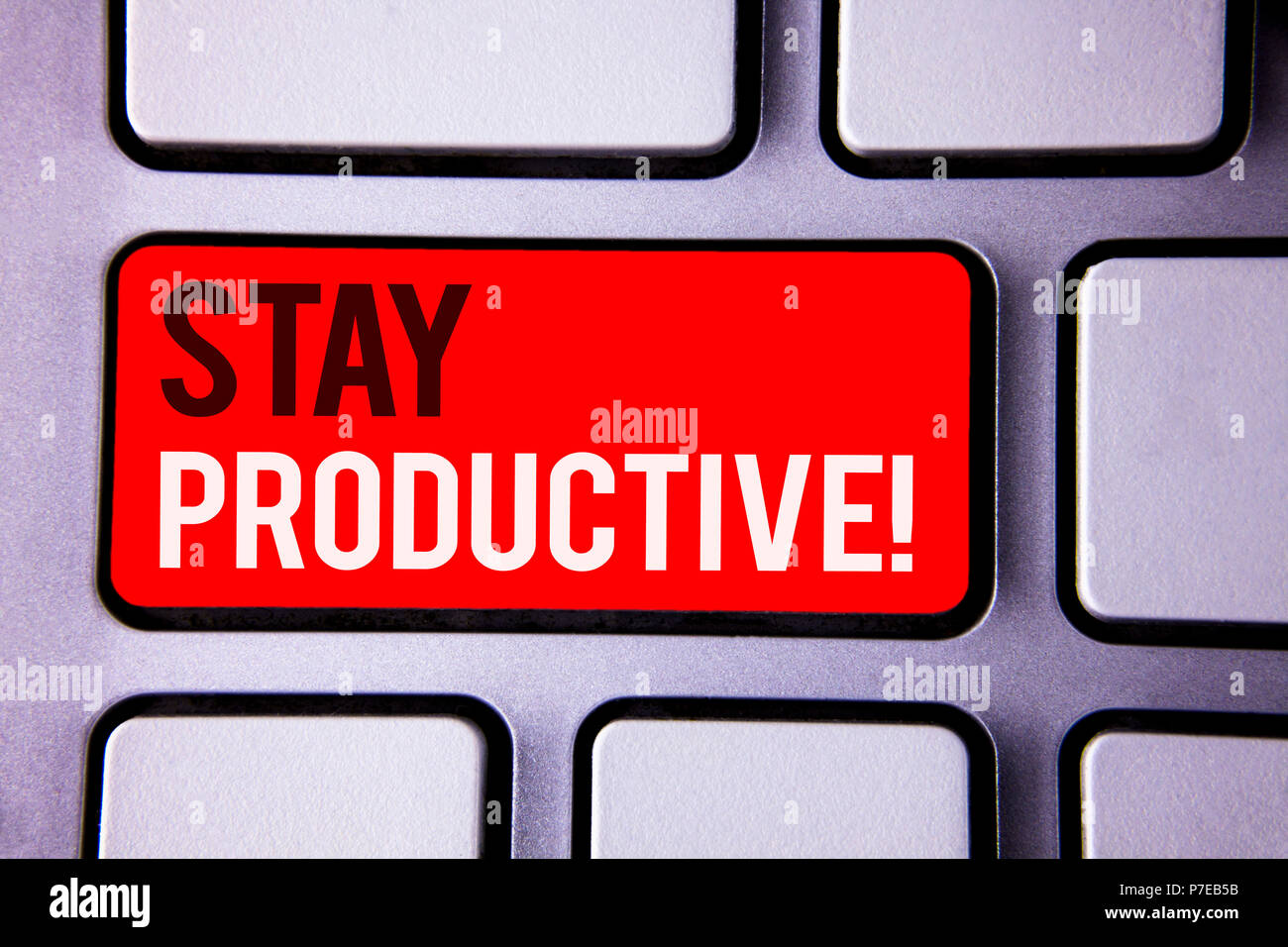 Word writing text Stay Productive Motivational Call. Business concept for Efficiency Concentration Productivity White Text two words red tab key butto - Stock Image