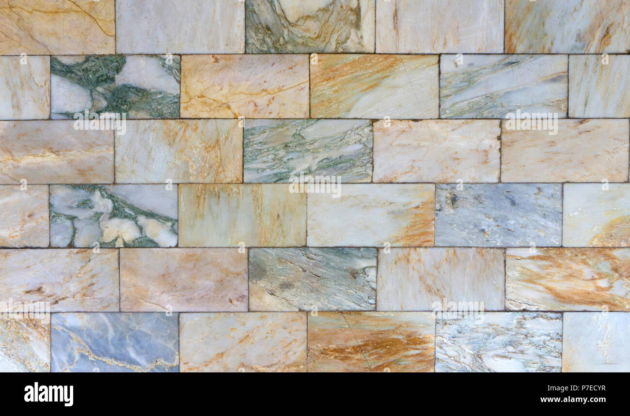 Background of marble used for wall decoration and bathroom interior. Marble is a metamorphic rock composed of recrystallized carbonate minerals, most  - Stock Image