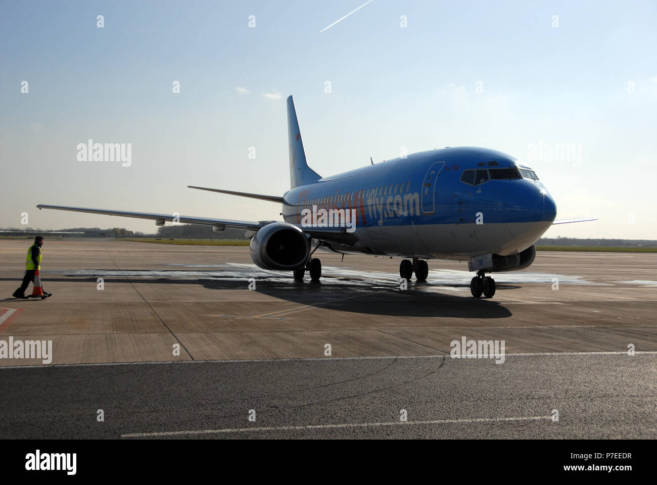 air staff greet a Thomson jet plane on airside tarmac at the Doncaster Sheffield Airport, formerly named Robin Hood Airport Doncaster Sheffield, - Stock Image
