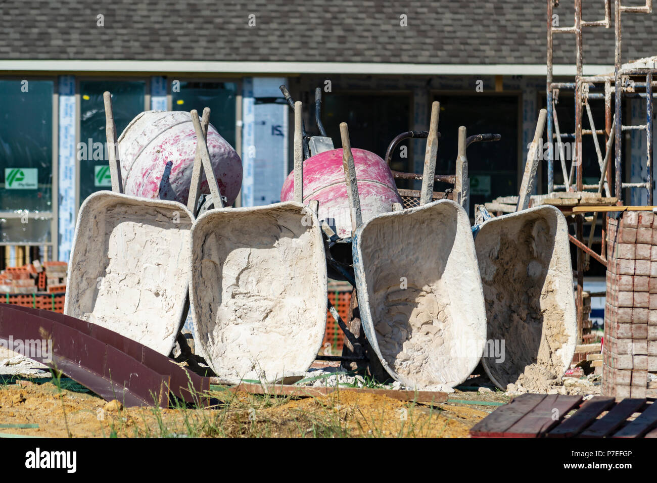 Row of wheelbarrows after a hard days work - Stock Image