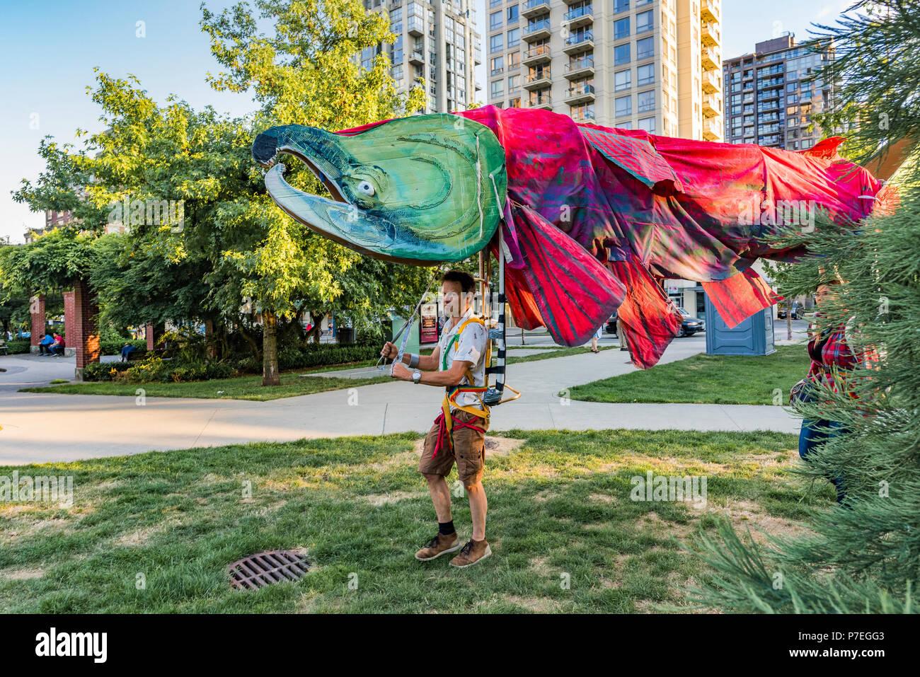 Sockeye Salmon puppet,  Gathering Festival, Summer Solstice Celebration, Vancouver, Emery Barnes Park, British Columbia, Canada. - Stock Image