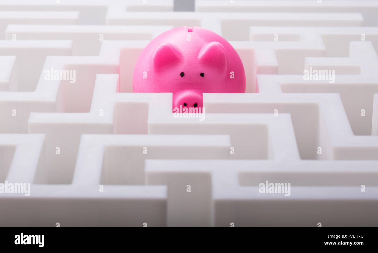 Close-up Of Pink Piggybank In The Centre Of White Maze - Stock Image