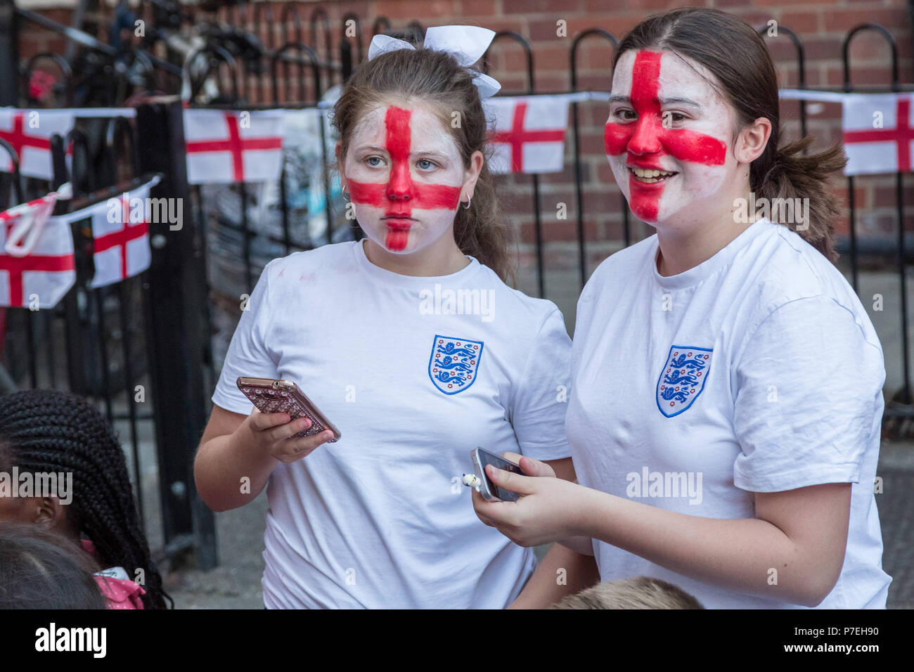 England fans from the Kirby estate in Bermondsey watch the FIFA 2018 World Cup match England vs Colombia. - Stock Image