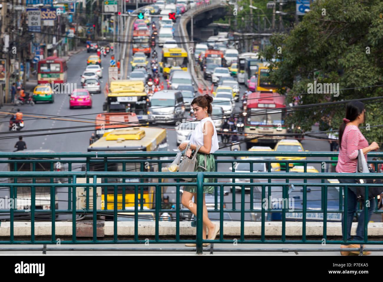 Pedestrian footbridge and traffic congestion in Bangkok, Thailand - Stock Image