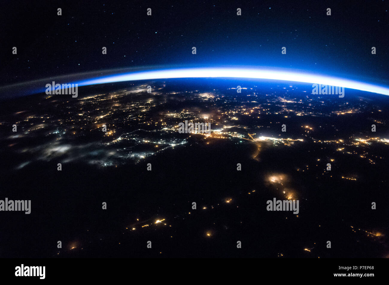 The International Space Station continues its orbit around the Earth as Expedition 50 astronauts captured this night image of sparkling cities and a sliver of daylight framing the northern hemisphere. - Stock Image