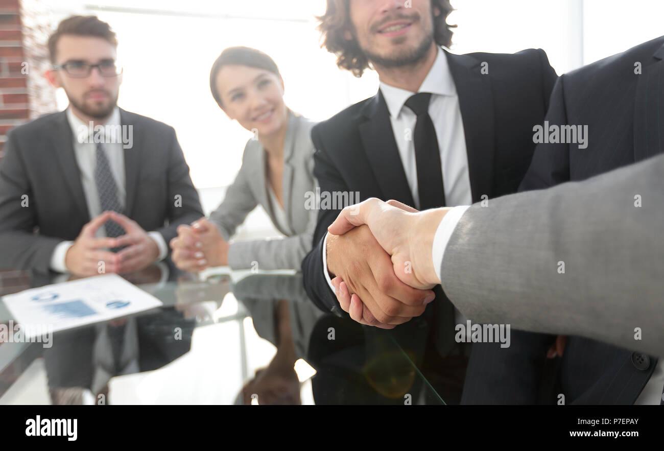 background image of handshake of business partners - Stock Image