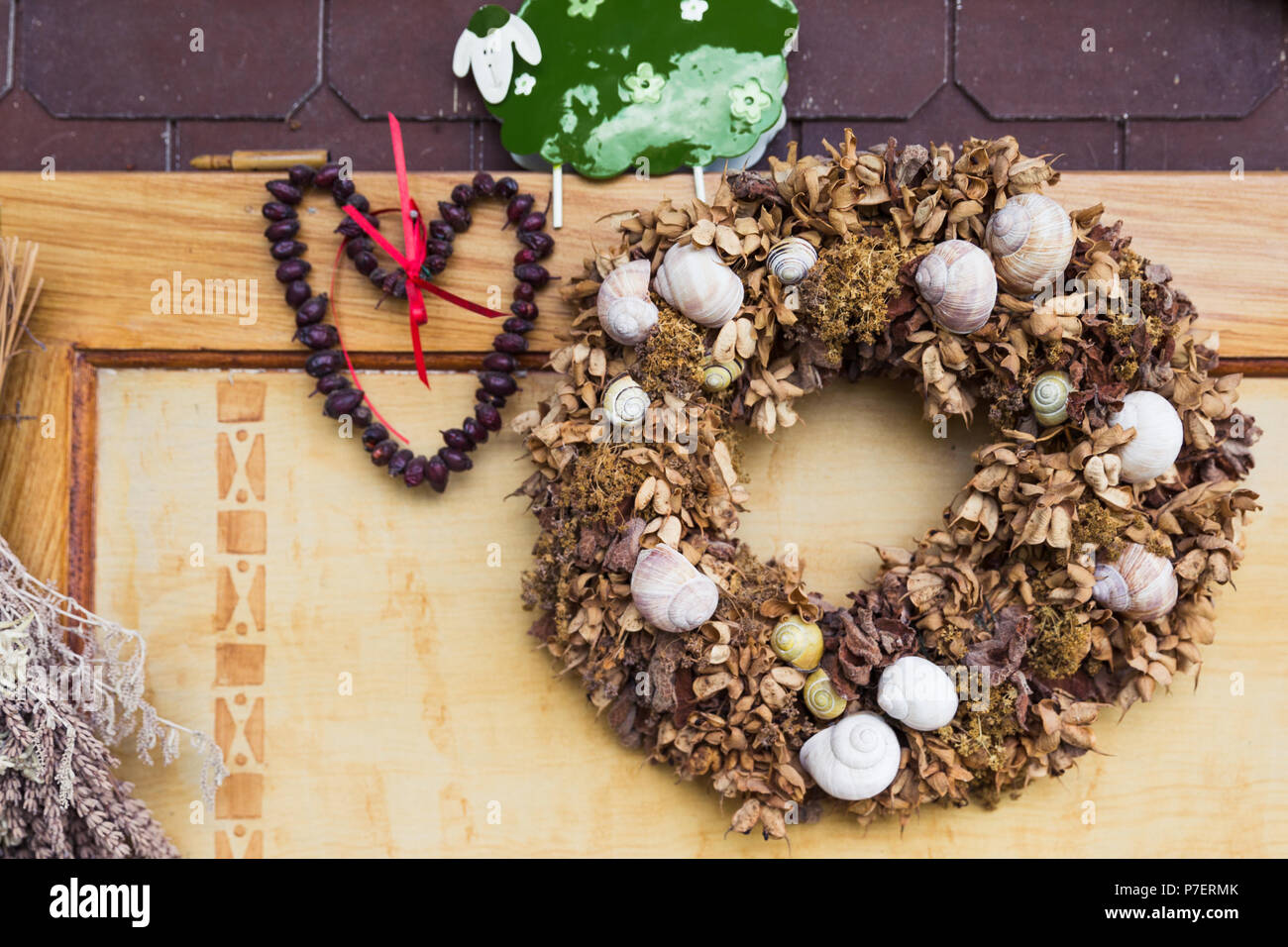 Home made Dried Flowers Crown and Snails Decorations - Stock Image