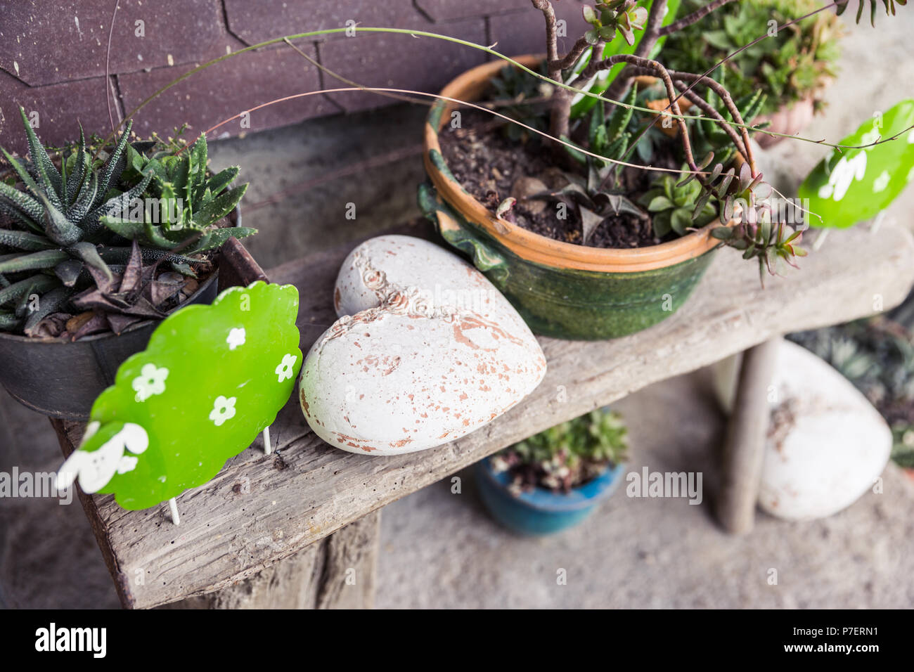 Shabby Chic Garden Decorations on Wooden Bench - Stock Image