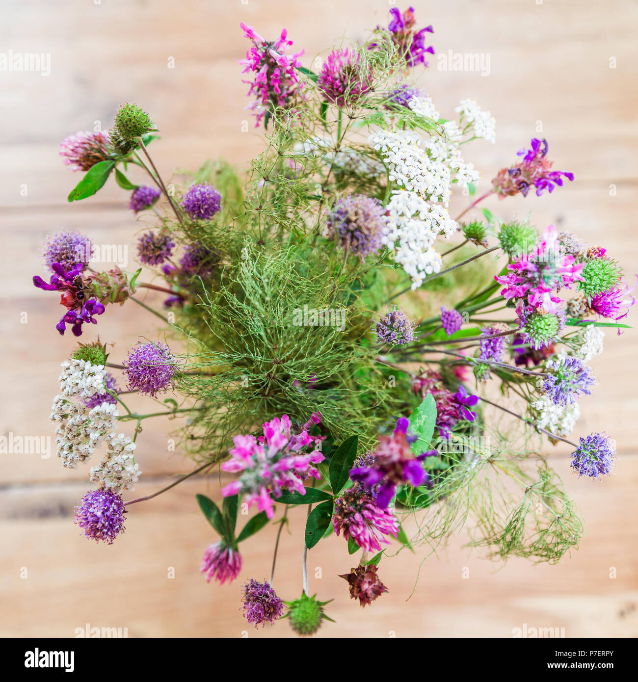 Home made fresh wild flowers bouquet on wooden table stock photo home made fresh wild flowers bouquet on wooden table izmirmasajfo