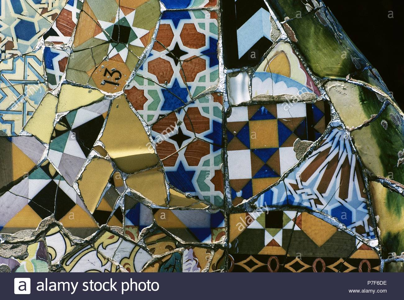 Barcelona, Catalonia, Spain. Park Guell, designed by Antonio Gaudi, 1900-1914. Mosaic on the main terrace, detail. Ceramic technique called Trencadis (fragments of ceramic). Catalan Modernism. - Stock Image