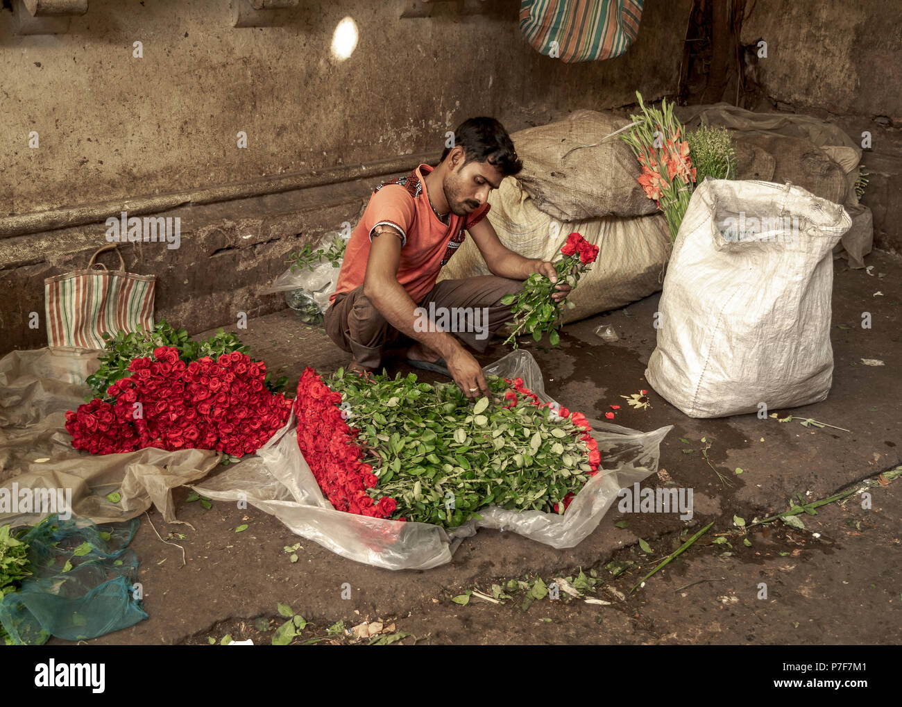 May 27,2018. Kolkata, India. Flower whole sellers busy with flower binding at Flower Market or Mullik Bazar , Kolkata. Stock Photo