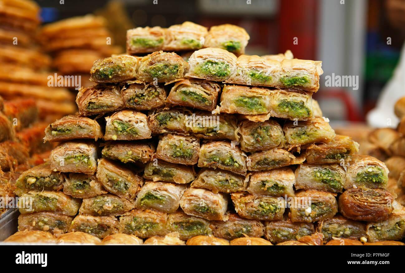Fresh Baklava stacked on the market in Tel Aviv, Israel - Stock Image