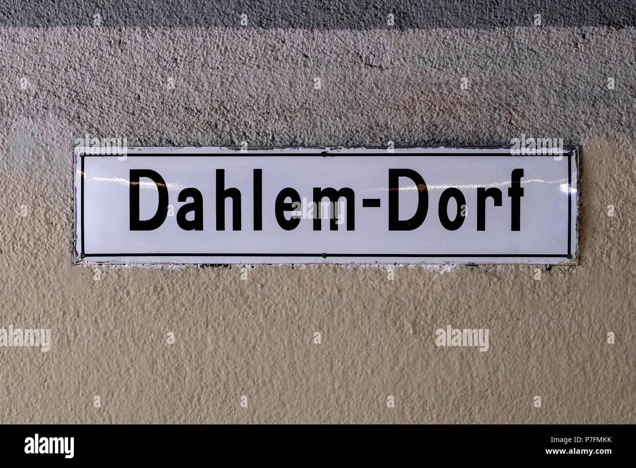 Berlin Dahlem-Dorf U-Bahn railway station sign on wall.Station was built in 1913 - Stock Image