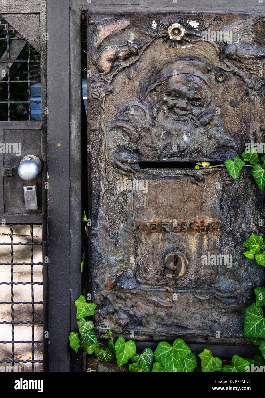 Berlin-Dahlem.dorf. Decorative old mail box, letter box at front gate of suburban home. - Stock Image