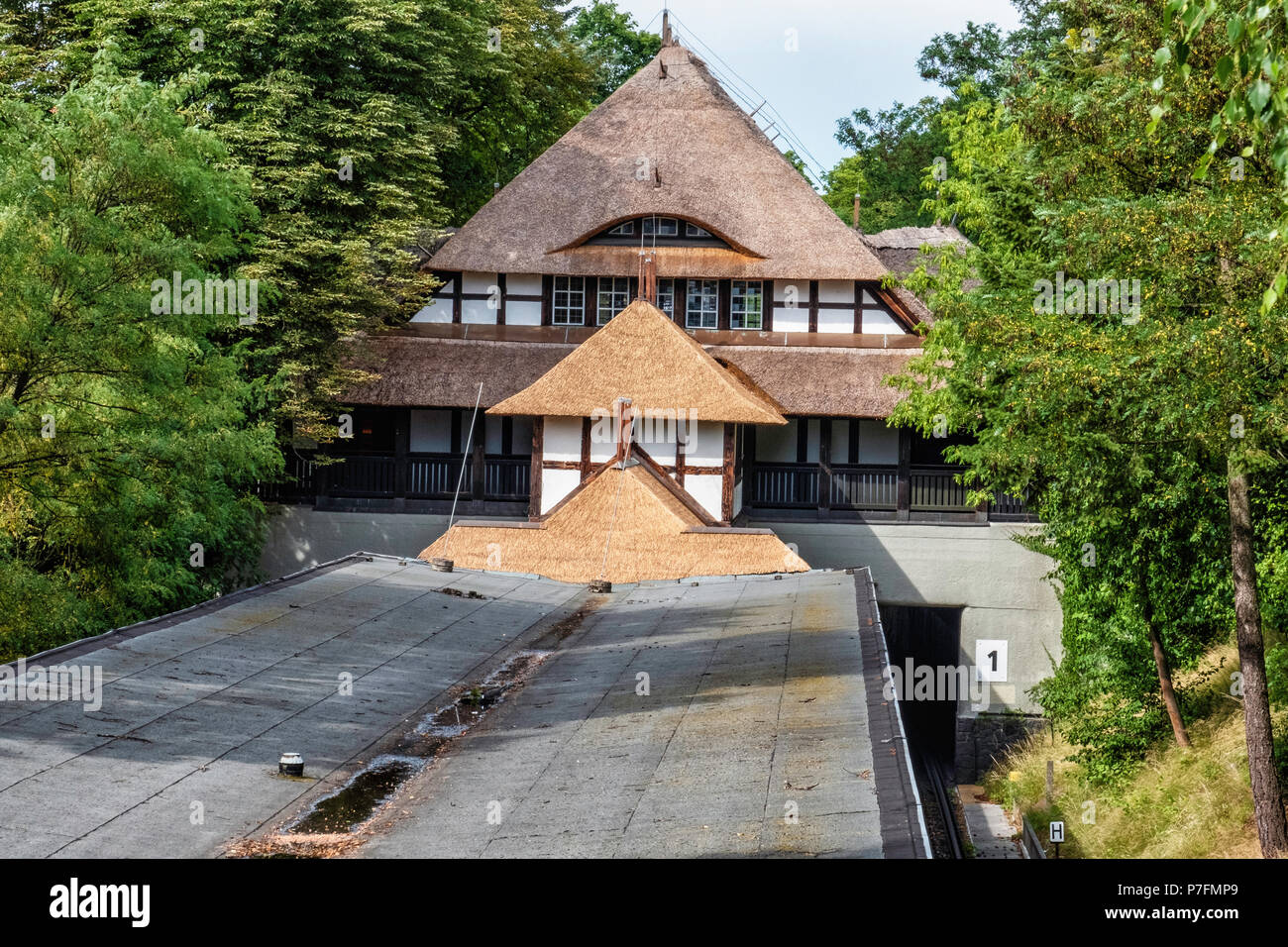 Berlin Dahlem-Dorf U-Bahn underground railway station on the U 3 line. Historic building exterior with thatched roof and tudor-style facade. - Stock Image