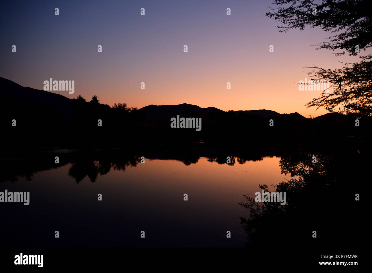 The Kunene River near the Epupa Falls at dawn, Kaokoveld, Namibia - Stock Image