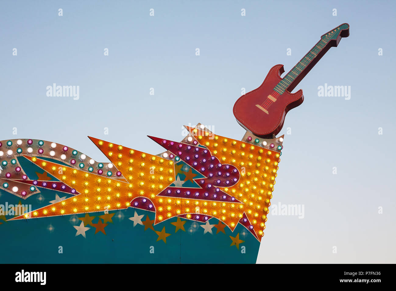 Decoration details from amusement park, electric guitar and light decor. - Stock Image