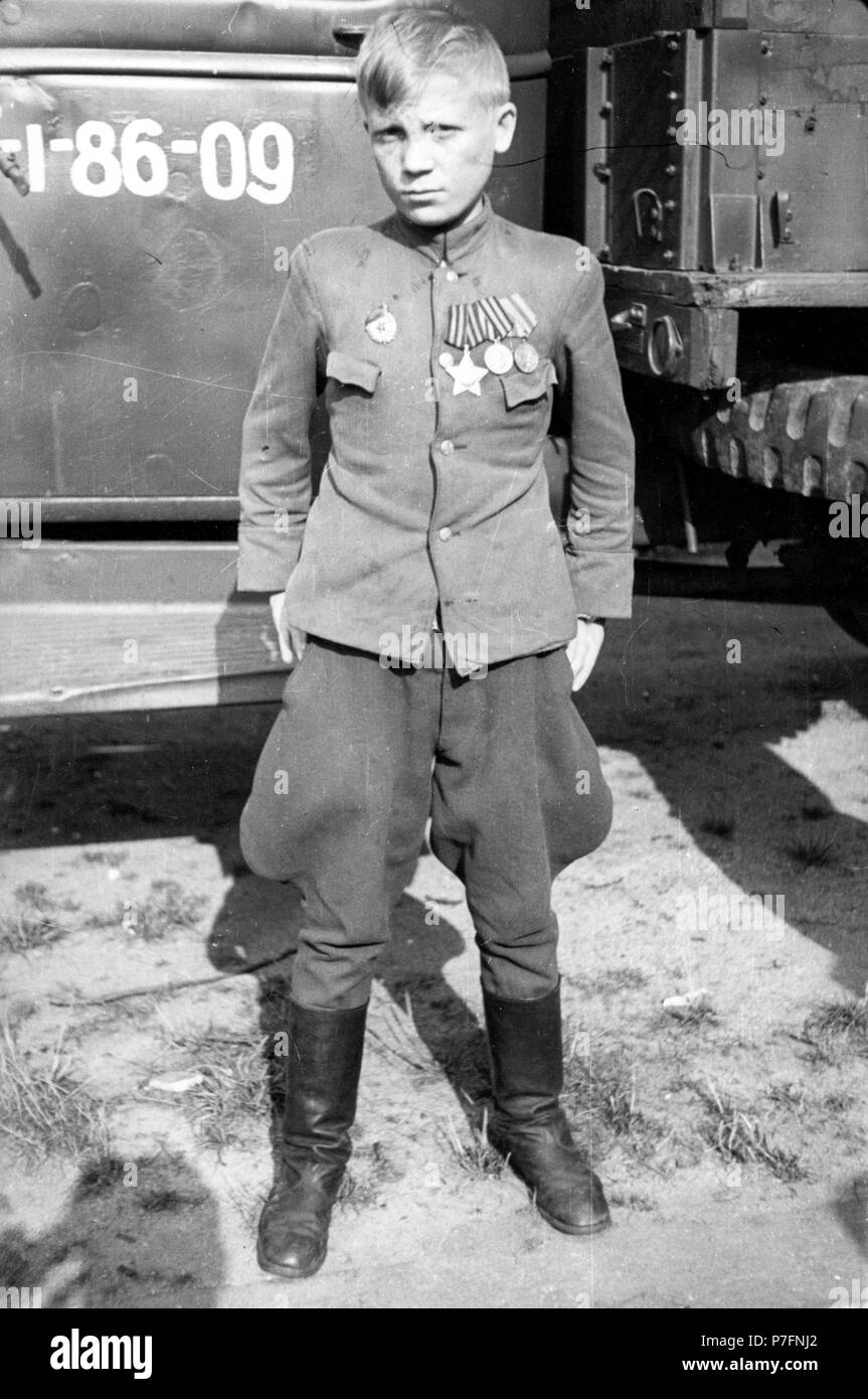 Boy with uniform and medal, ca. 1945, Leipzig, Germany - Stock Image