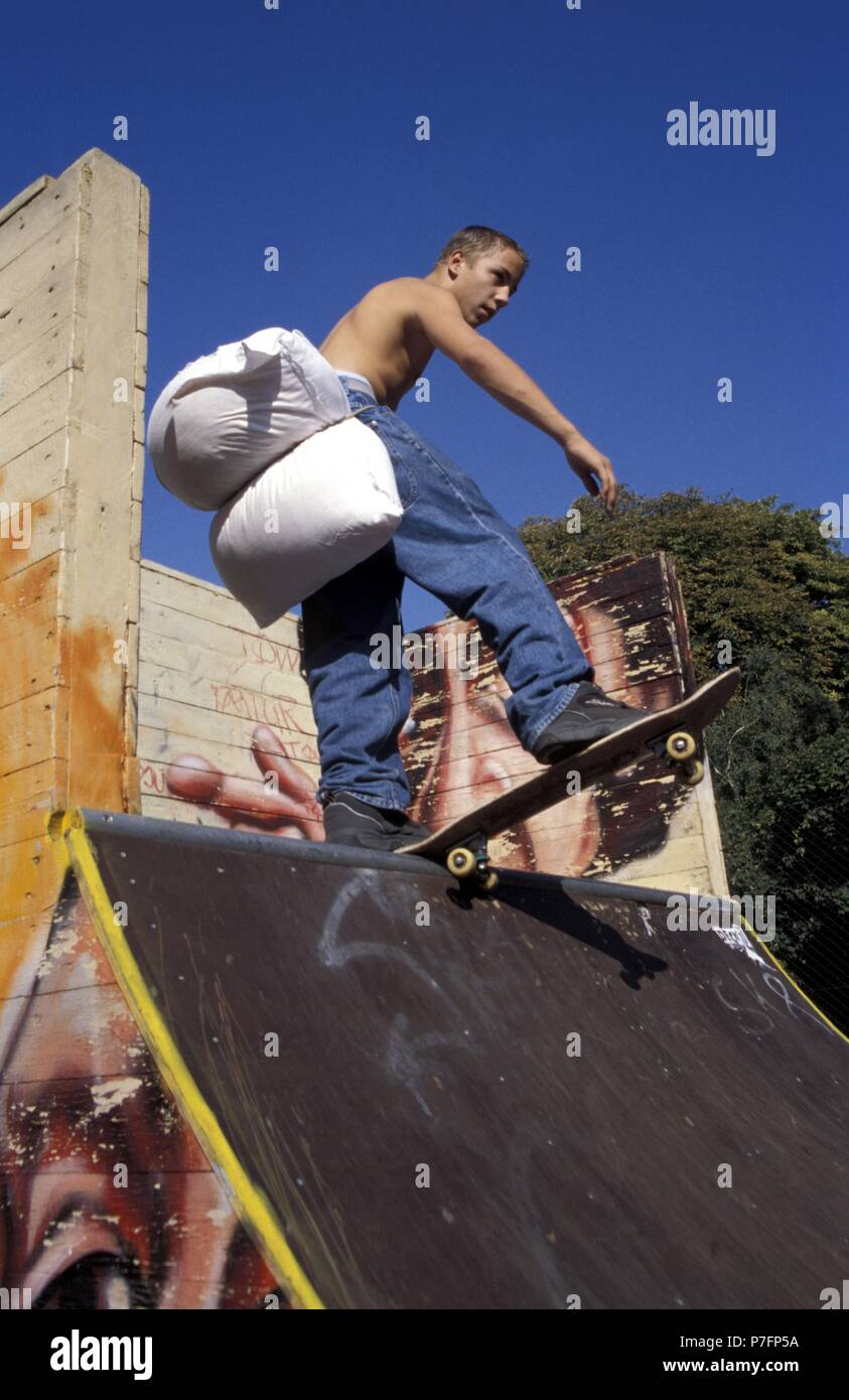 Careful skateboarding, protection by cushions at the bottom on a ramp, Berlin, Germany - Stock Image