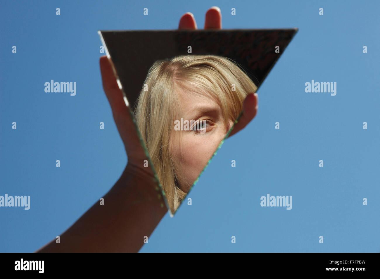Identity crisis, Woman reflected, Germany - Stock Image