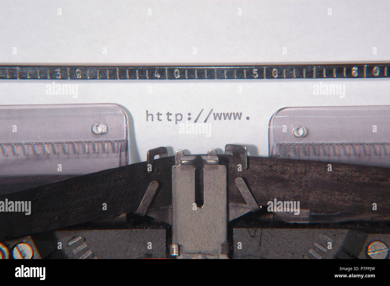 Sheet of paper in a typewriter with the letters http://www., Internet caricature - Stock Image