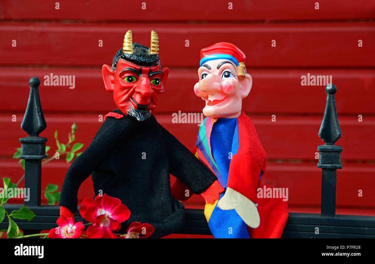Punch puppets, punch and devil sitting on a metal bridle - Stock Image