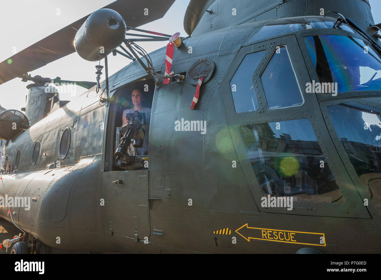 London, UK. 6th July 2018. A weather presenter sets up a shot on the Chinook, the twin-rotor helicopter - RAF 100, Horse Guards Parade. As part of the 100th Anniversary celebrations of the Royal Air Force, an exhibition of aircraft covering the RAF's history, from WW1 and WW2 through to the modern age. Credit: Guy Bell/Alamy Live News - Stock Image