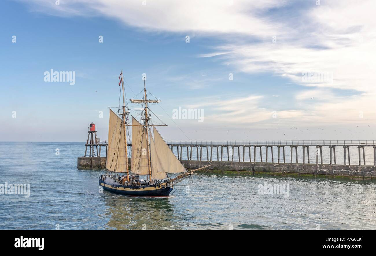 Whitby, UK. 6th July 2018. Whitby Captain Cook Festival 2018. HMS Pickle replica enters Whitby Harbour firing her canon. Credit: Jack Cousin/Alamy Live News - Stock Image