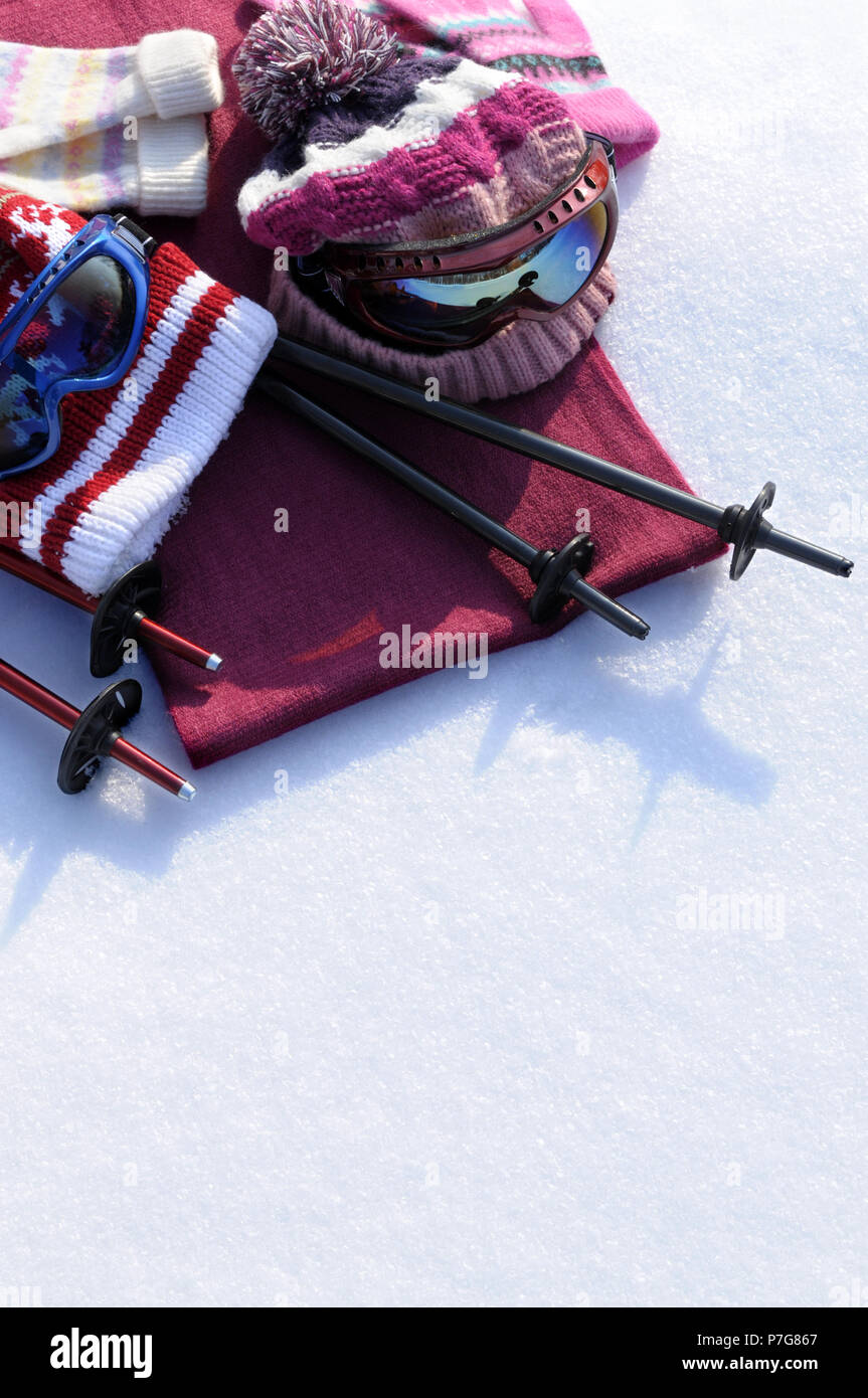 040b0c2ad Winter sports background with ski poles, goggles, hats and gloves ...