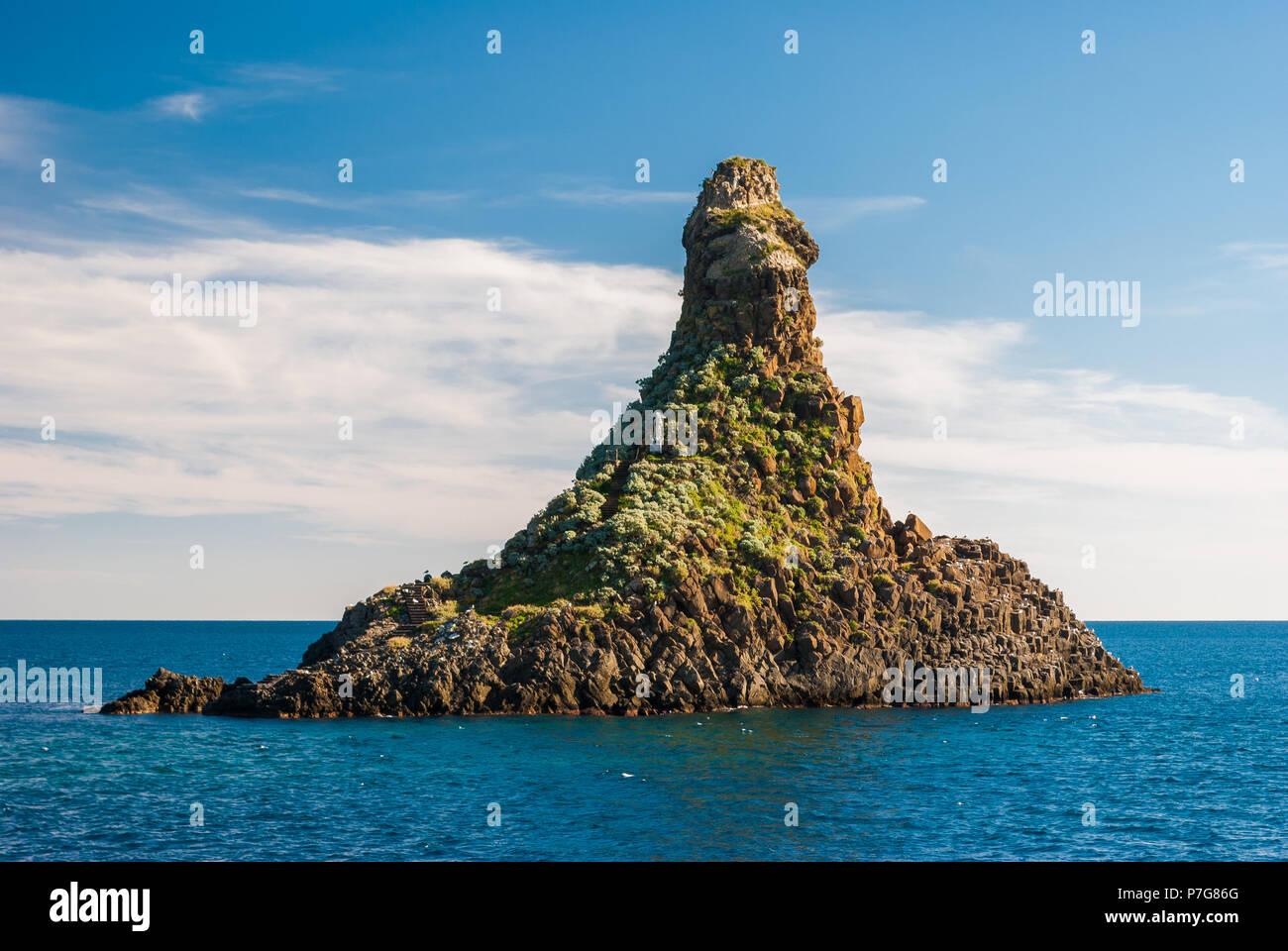 One of the sea stacks in Acitrezza (Catania, Sicily), called Faraglione Grande - Stock Image