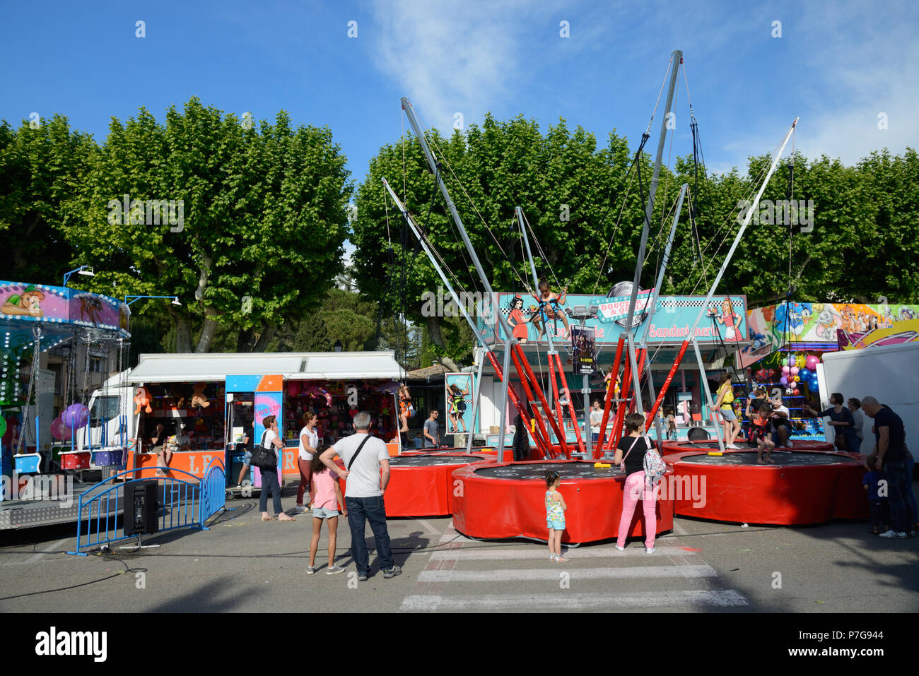 Fun Fair and Elasticated Trampoline or Bungee Trampoline Harness Vaison-la-Romaine France - Stock Image