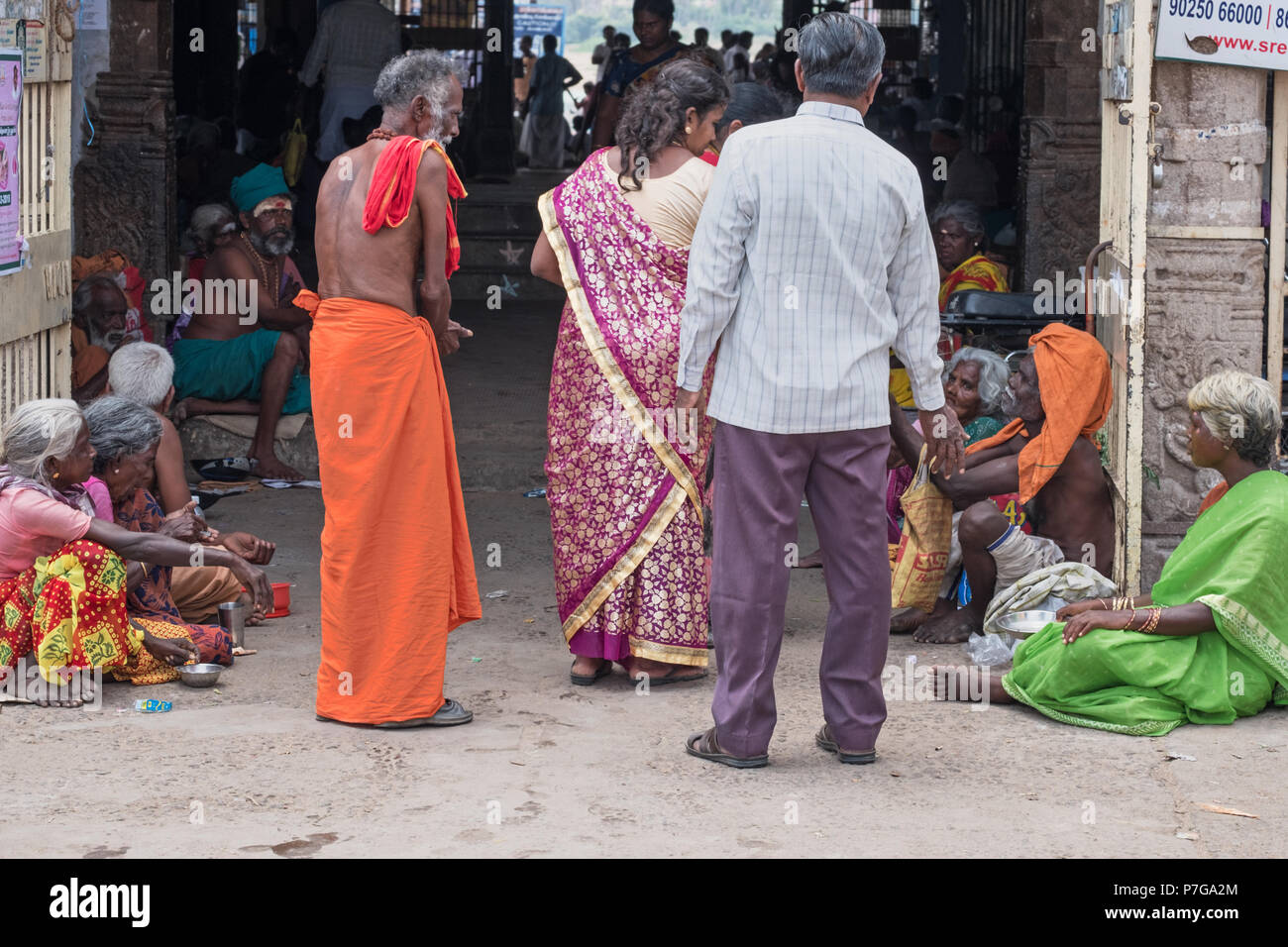 Trichy, India - March 14, 2018: Beggars lining the entrance to the Amma Mandapa ghats on the Kaveri river,  a highly auspicious place for Hindus - Stock Image