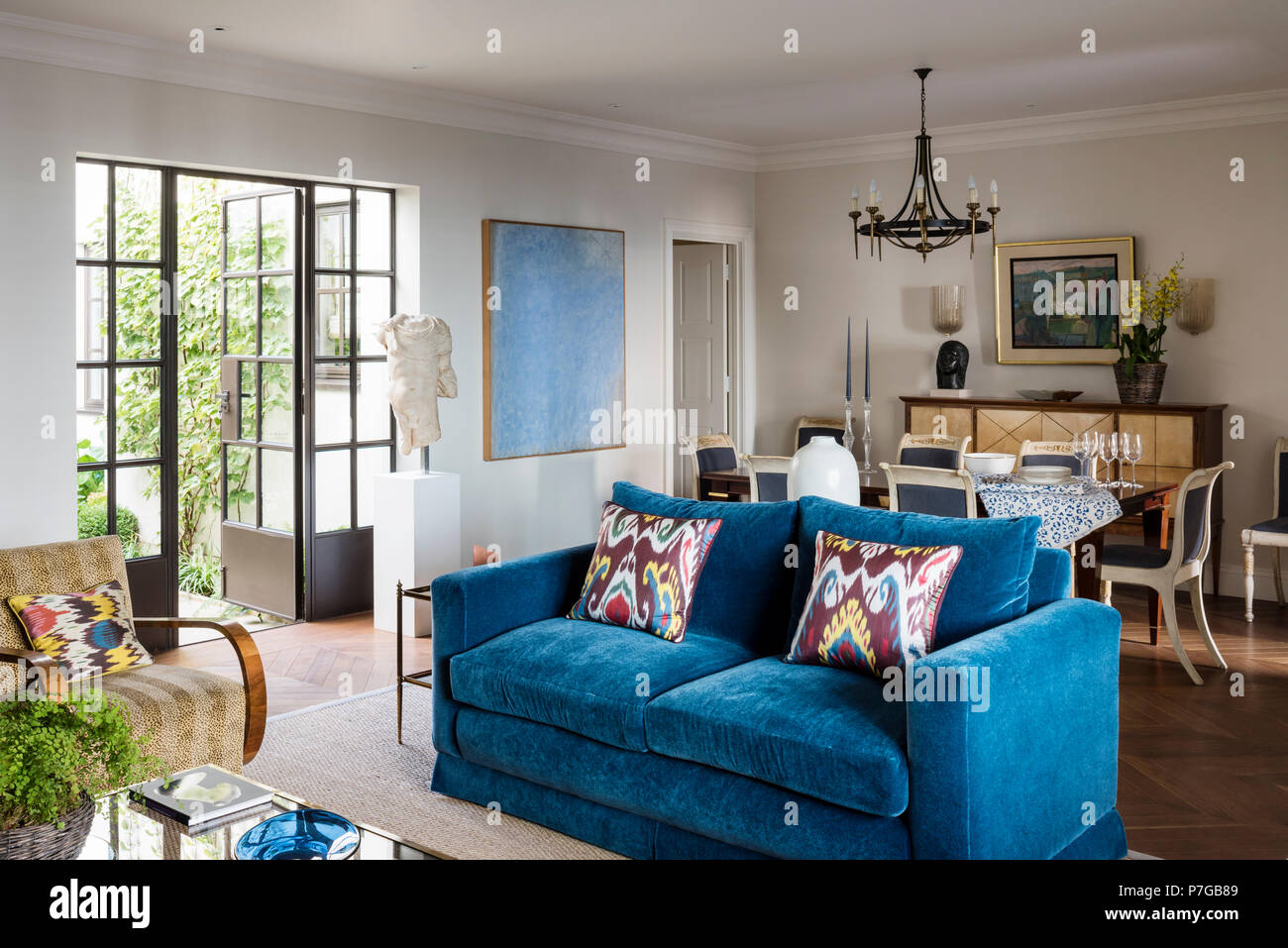 Blue sofa in country style living room Stock Photo: 211187097 - Alamy