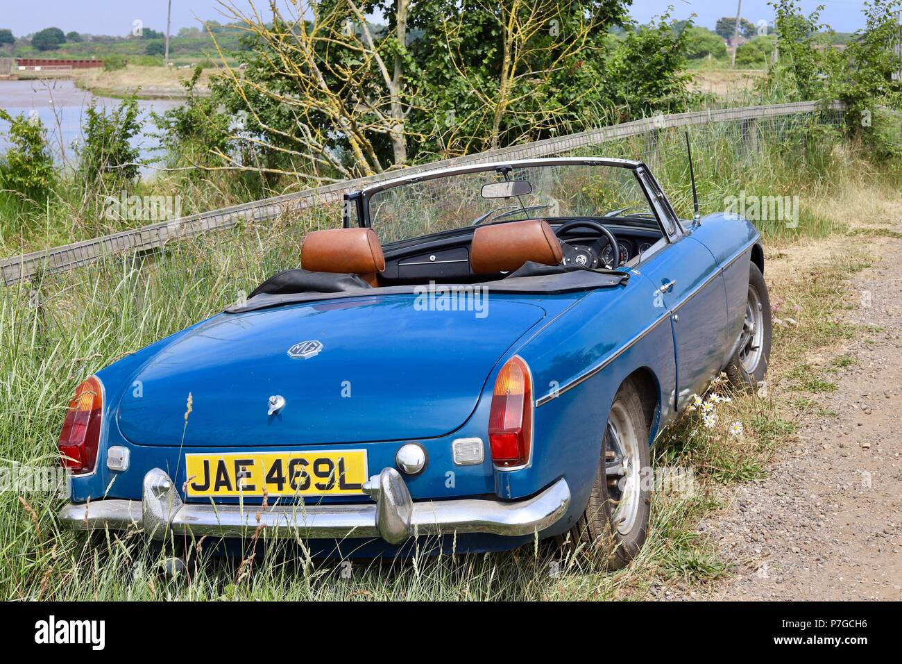 Vintage blue two-seater MG Midget open top sports car. Estimated ...