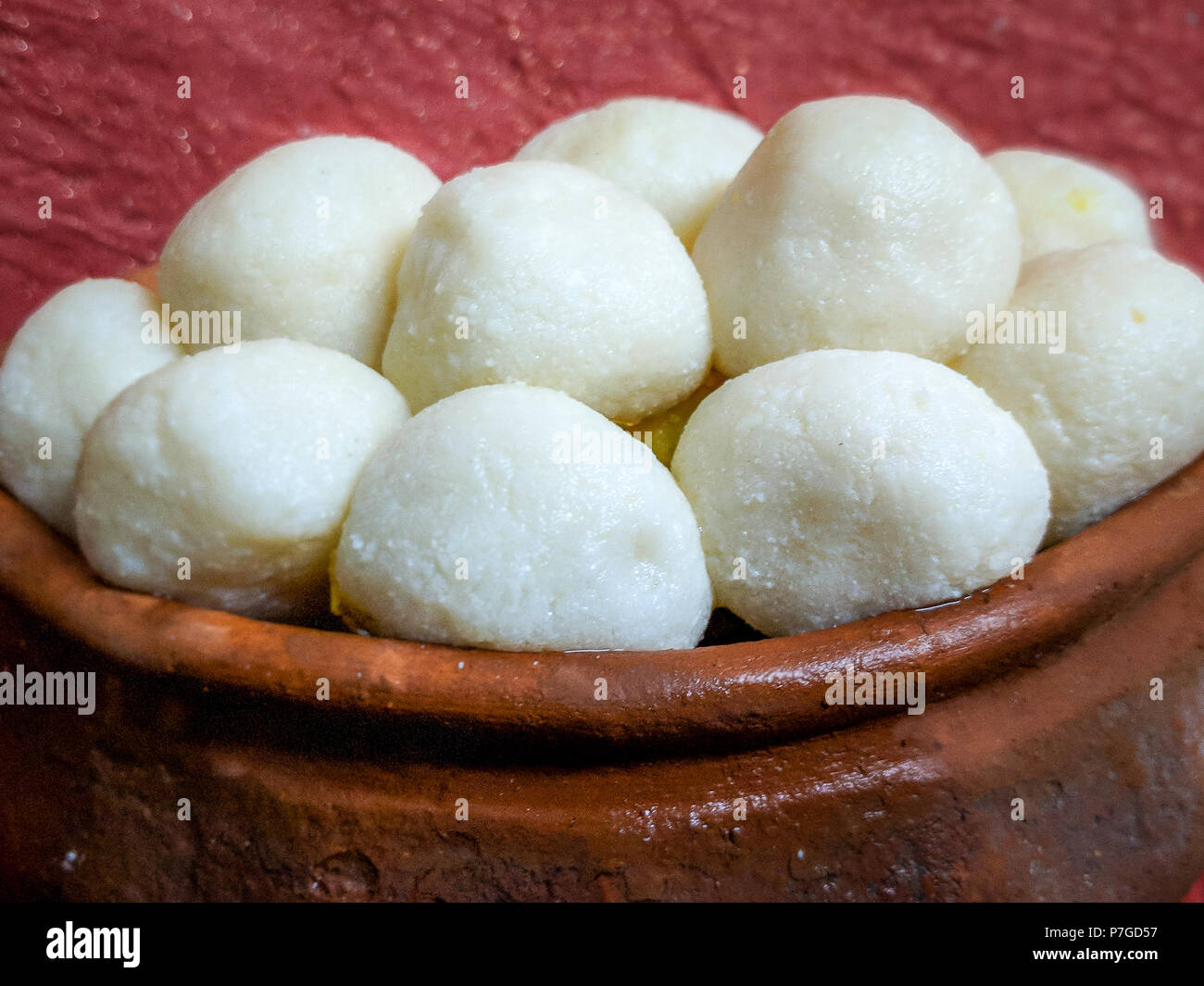 Indian Sweet Rasgulla Also Know as Rosogolla, Roshogolla, Rasagola, Ras Gulla is a Syrupy Dessert Popular in India. Selective focuse is used. - Stock Image