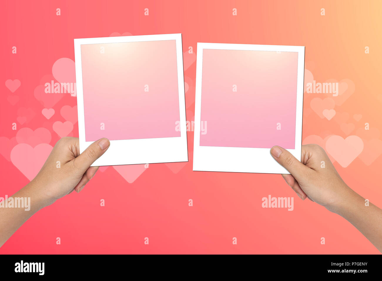 Hands Hold Blank Photo Frame On Pink Valentines Day Background
