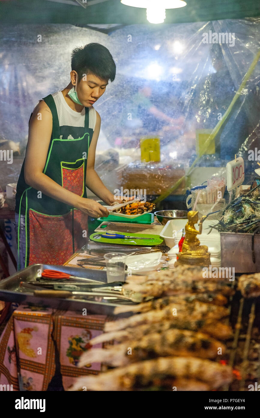 CHIANG MAI, THAILAND - AUGUST 27: Food vendor prepares seafood at the Saturday Night Market (Walking Street) for sale on August 27, 2016 in Chiang Mai - Stock Image