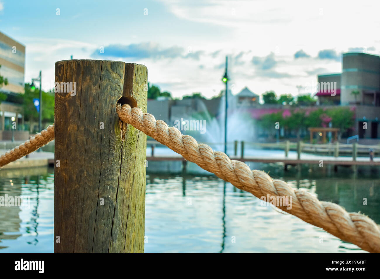 Wooden Pillar With Rope In Front Of Waterfall And Pond The Shoppes
